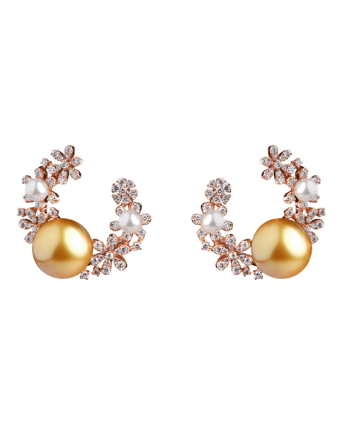 photo of white & golden pearl earrings