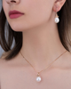 diamond and pearl earrings on rose gold